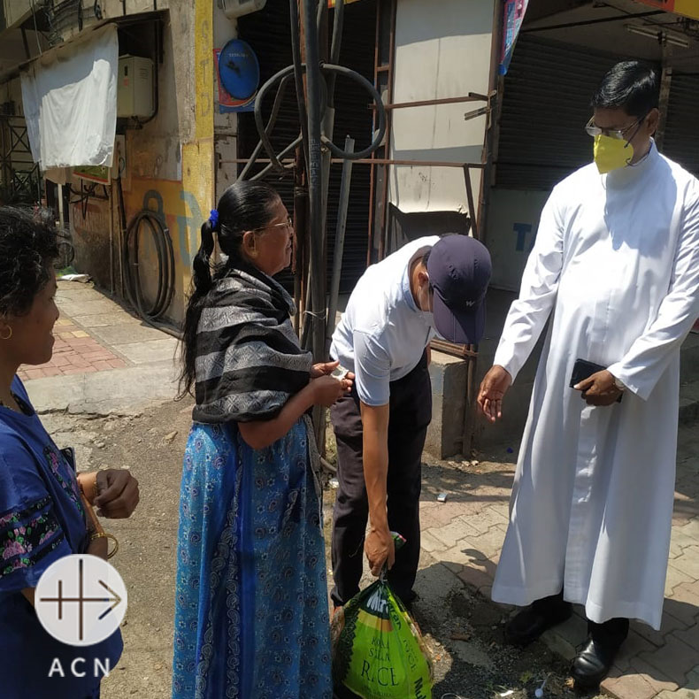 Small Christian Communities (SCCs) helping the population affected by Corona Virus in India - March 2020: People receiving relief supplies from their  priest.